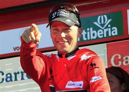 Chris Horner of the U.S. celebrates on the podium after retaking the overall race lead in the 181-km 19th stage of the Vuelta, Tour of Spain cycling race from San Vicente de la Barquera to Alto del Naranco, September 13, 2013. REUTERS/Joseba Etxaburu