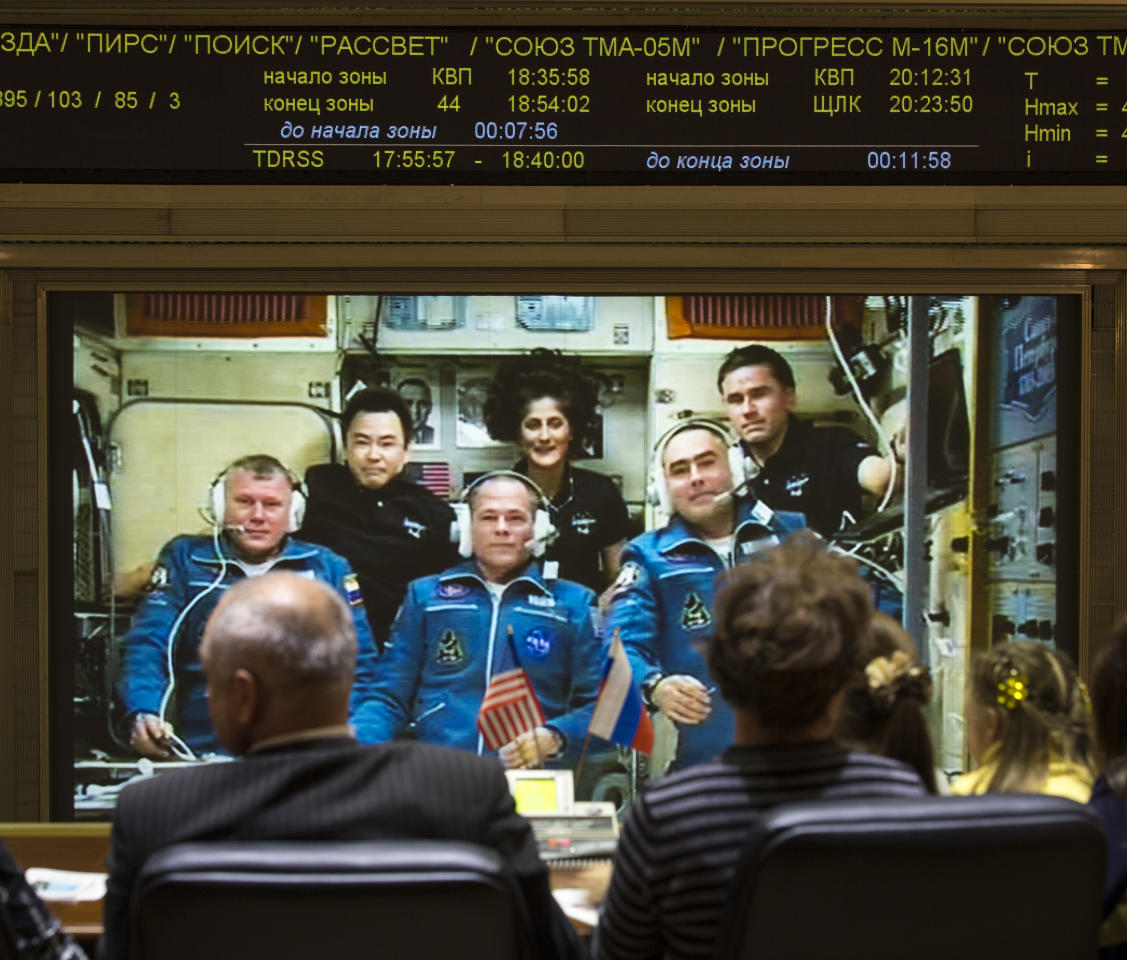 In this handout image provided by NASA, family of the newly arrived International Station Expedition 33/34 crew members, Russian cosmonaut Oleg Novitskiy, front left, NASA astronaut Kevin Ford, front center, and Russian cosmonaut Evgeny Tarelkin, front right, talk via phone to the crew from the Russian Mission Control Center shortly after the three joined Flight Engineer Aki Hoshide of the Japan Aerospace Exploration Agency, back left, Expedition 33 Commander Sunita Williams of NASA, back center, and Yuri Malenchenko of the Russian Federal Space Agency October 25, 2012 in Korolev, Russia. The Soyuz TMA-06M with Expedition 33/34 crew members, NASA astronaut Kevin Ford and Russian cosmonauts Oleg Novitskiy and Evgeny Tarelkin launched from the Baikonur Cosmodrome in Kazakhstan two days ago. The Soyuz crew members were greeted by Expedition 33 Commander Sunita Williams of NASA and Flight Engineers Aki Hoshide of the Japan Aerospace Exploration Agency and Yuri Malenchenko of the Russian Federal Space Agency, who have lived in the orbital laboratory since July.  (Photo by Bill Ingalls/NASA via Getty Images)