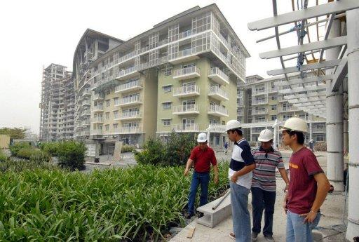 Engineers inspect construction progress at the Serendra condominium project of Ayala Land