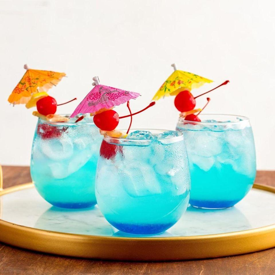 """<p>The combo of lemonade, blue curacao, and rum works miracles in this tropical cocktail that will make you feel like a mermaid.</p><p>Get the <a href=""""https://www.delish.com/uk/cocktails-drinks/a33389295/mermaid-lemonade-recipe/"""" rel=""""nofollow noopener"""" target=""""_blank"""" data-ylk=""""slk:Mermaid Lemonade"""" class=""""link rapid-noclick-resp"""">Mermaid Lemonade</a> recipe.</p>"""