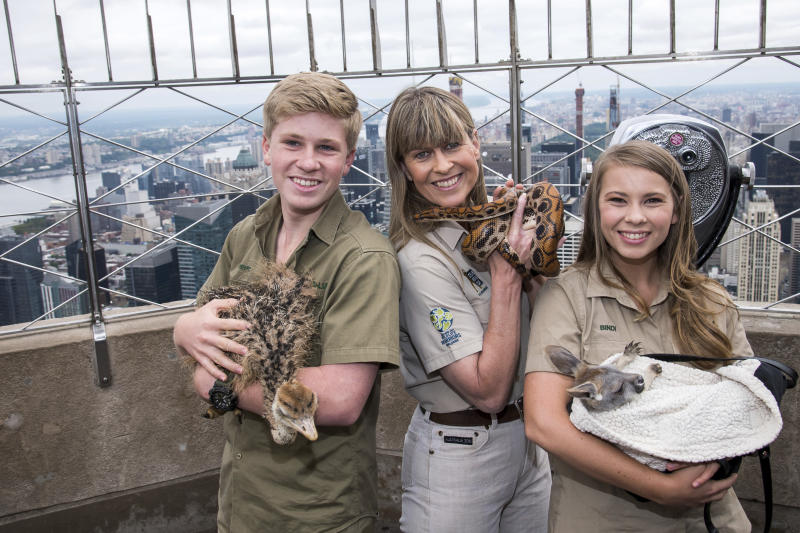 "Robert, from left, Terri and Bindi Irwin visit the 86th floor observation deck at the Empire State Building to promote their new Animal Planet television show ""Crikey! It's The Irwins"" on Thursday, Sept. 20, 2018, in New York. (Photo by Charles Sykes/Invision/AP)"