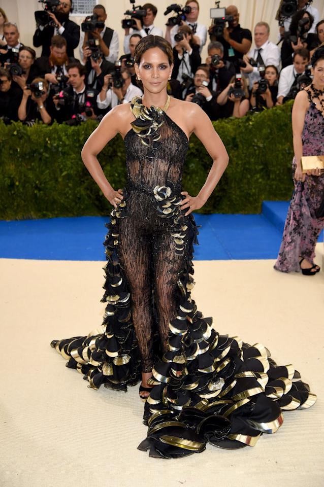 <p>The former Bond star turned to Atelier Versace for her show-stopping 2017 Met Gala outfit. The look was effectively a semi-sheer catsuit with a half-skirt attached at the waist. [Photo: Getty] </p>