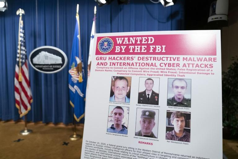 An FBI poster shows six Russian military intelligence officers accused of staging cyberattacks