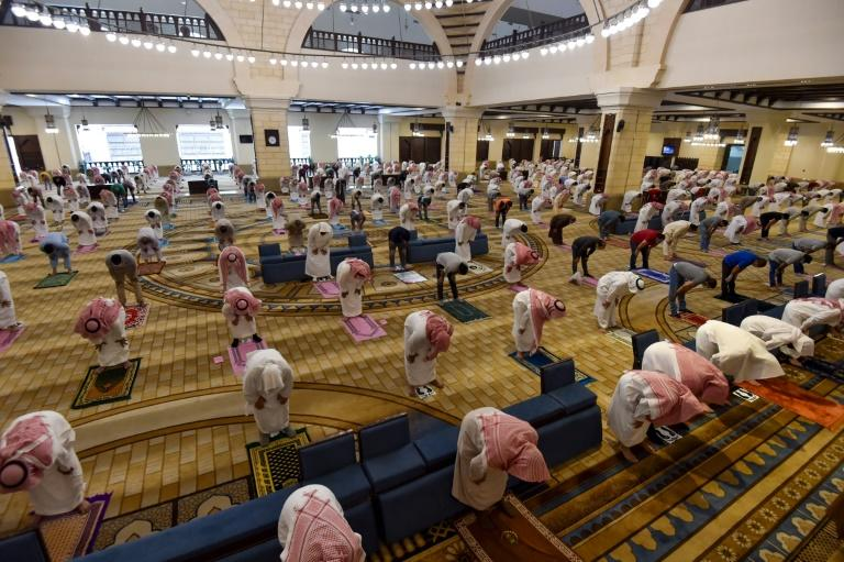 Saudi Muslim worshippers maintain a safe distance as they perform noon prayers at Al-Rajhi mosque in the capital Riyadh on Sunday