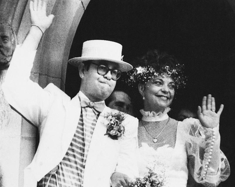 British rock star Elton John with his bride, Renate Blauel, wave upon leaving St. Mark's church in Sydney, Australia, Feb 14,1984. (AP Photo)