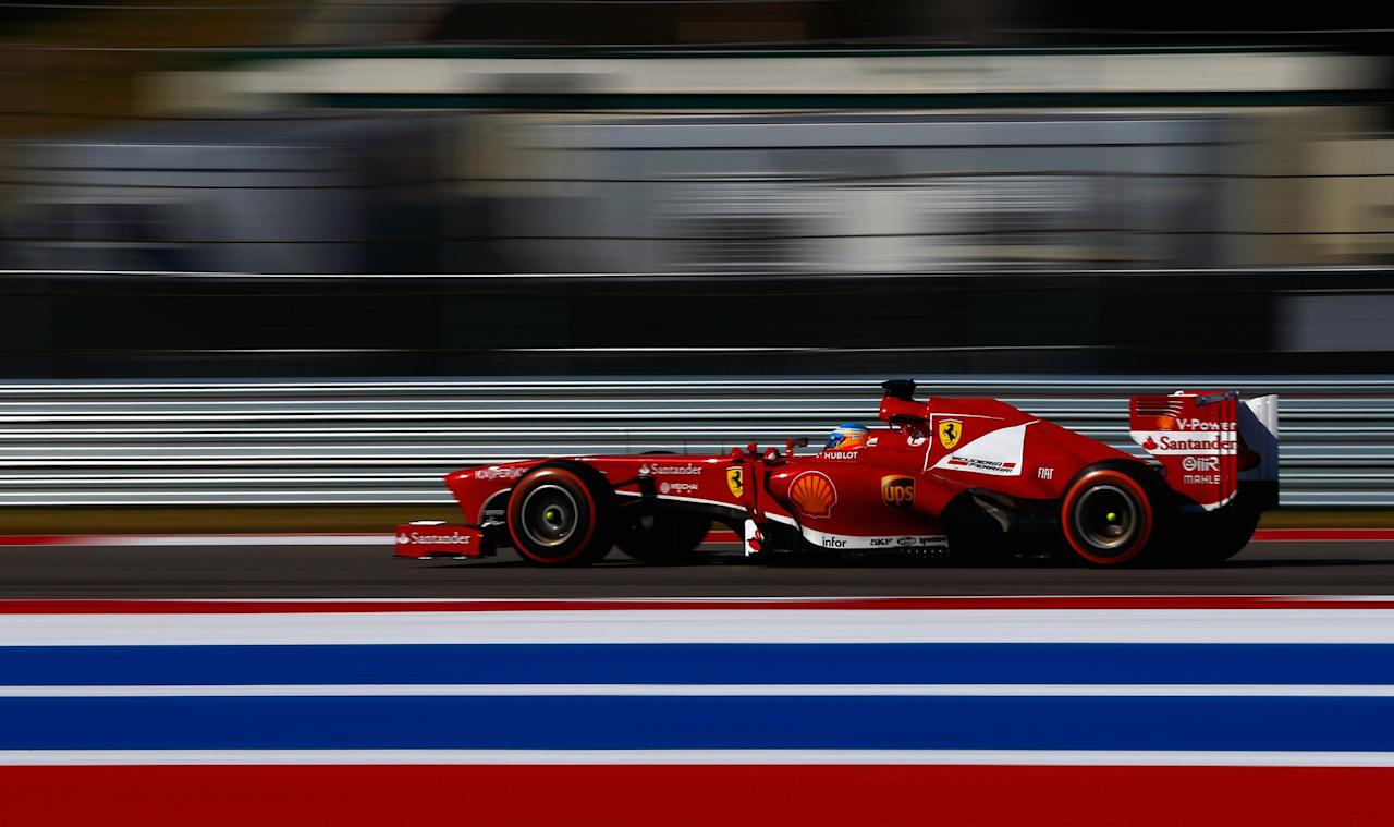 AUSTIN, TX - NOVEMBER 17: Fernando Alonso of Spain and Ferrari drives during the United States Formula One Grand Prix at Circuit of The Americas on November 17, 2013 in Austin, United States.