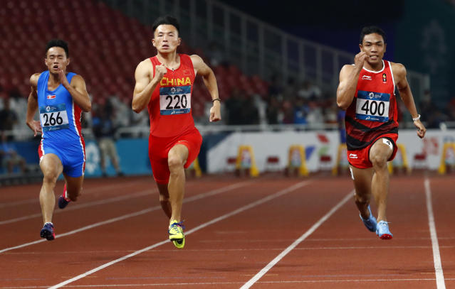 Indonesia's Lalu Zohri, right, and China's Xie Zhenye run in their heat of the men's 100m during the athletics competition at the 18th Asian Games in Jakarta, Indonesia, Saturday, Aug. 25, 2018. (AP Photo/Bernat Armangue)