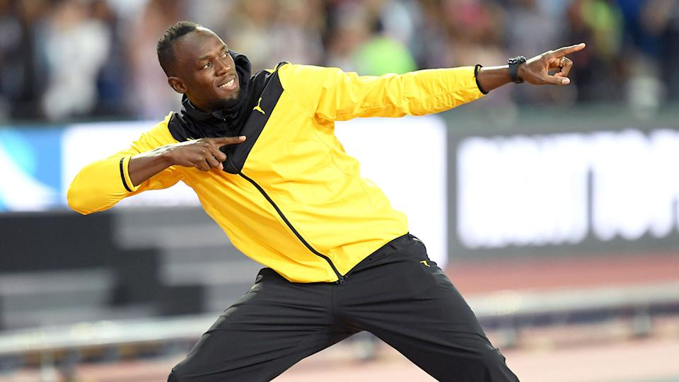 Seen here, Usain Bolt does his trademark pose for photographers.