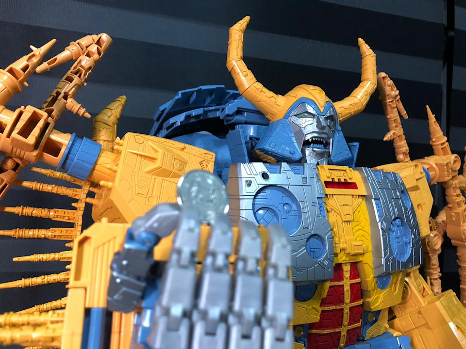 Unicron with a 10-cent coin.