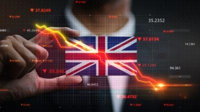 Graph Falling Down in Front Of United Kingdom Flag