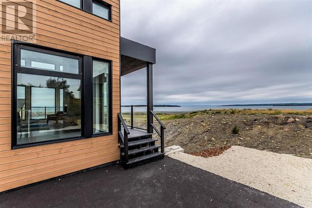 "<p><a href=""https://www.zoocasa.com/conception-bay-south-nl-real-estate/5332710-8-commodore-place-conception-bay-south-nl-a1w0a9-1175937"" rel=""nofollow noopener"" target=""_blank"" data-ylk=""slk:8 Commodore Place, Conception Bay, Nfld."" class=""link rapid-noclick-resp"">8 Commodore Place, Conception Bay, Nfld.</a><br> Outside you'll find an additional 600 square feet of living space, with a covered barbecue area and large viewing deck.<br> (Photo: Zoocasa) </p>"