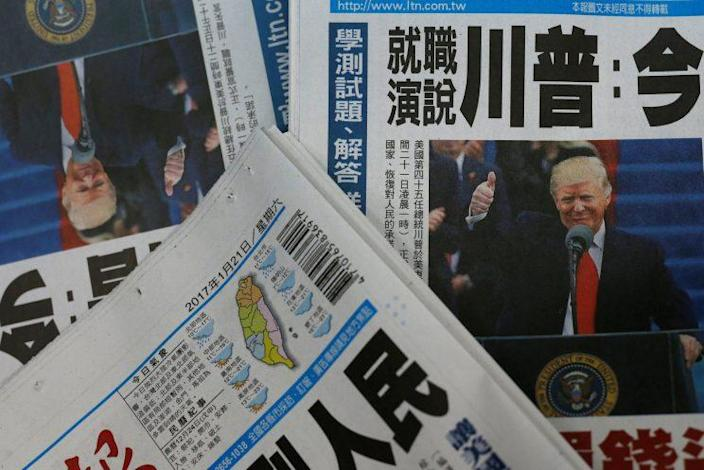 Copies of the Taiwanese daily newspaper Liberty Times, with its front page on the inauguration of President Trump. (Photo: Tyrone Siu/Reuters)