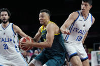 Australia's Dante Exum (11) drives against against Italy's Michele Vitali (31) and Simone Fontecchio (13) during a men's basketball preliminary round game at the 2020 Summer Olympics, Wednesday, July 28, 2021, in Saitama, Japan. (AP Photo/Eric Gay)