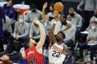 Phoenix Suns center Deandre Ayton (22) beats Toronto Raptors center Aron Baynes (46) to the ball on the opening tip-off during the first half of an NBA basketball game Wednesday, Jan. 6, 2021, in Phoenix. (AP Photo/Ross D. Franklin)