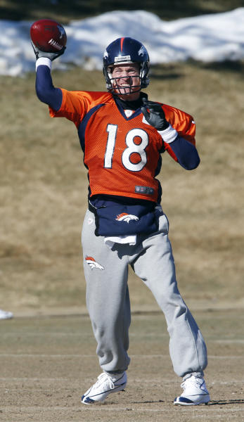 Broncos quarterback Peyton Manning throws a pass during NFL football practice at the team's training facility in Englewood, Colo., on Friday, Jan. 24, 2014. The Broncos are scheduled to play the Seattle Seahawks in Super Bowl XLVIII on Feb. 2. (AP Photo/Ed Andrieski)