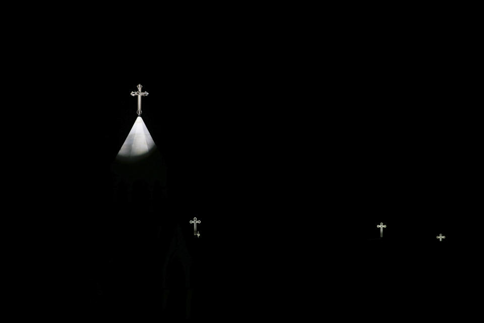 Crosses are lit on the Church of the Nativity, traditionally believed by Christians to be the birthplace of Jesus Christ, during the Christmas tree lightning ceremony in the West Bank city of Bethlehem, Saturday, Dec. 5, 2020. (AP Photo/Majdi Mohammed)