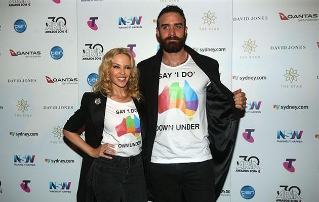 The engaged pair wore matching tees at the ARIAs. Source: Getty Images.