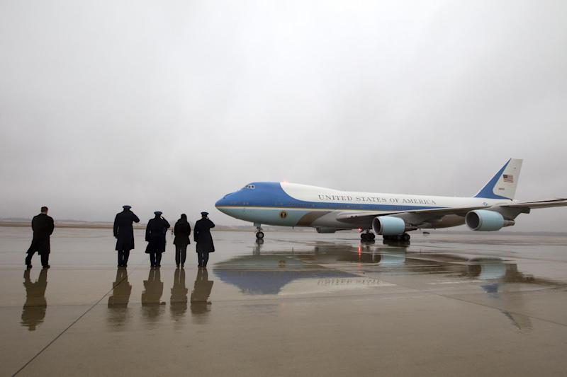 Military personnel salute as Air Force One with President Barack Obama and first family aboard arrives at Andrews Air Force Base, Md., Monday, Jan. 2, 2017. President and his family are returning from vacation in Hawaii. ( AP Photo/Jose Luis Magana)