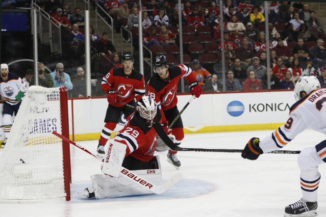 New Jersey Devils goaltender Mackenzie Blackwood (29) watches the puck sail into the net on a goal by Edmonton Oilers center Leon Draisaitl (29) during the first period of an NHL hockey game Thursday, Oct. 10, 2019, in Newark, N.J. (AP Photo/Kathy Willens)