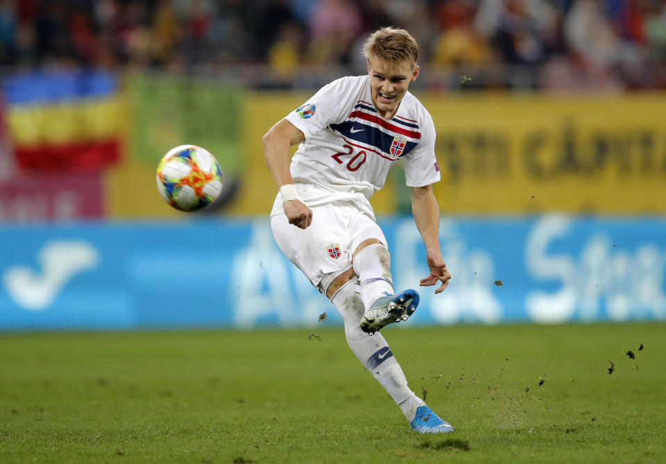 Norway's Martin Odegaard kicks the ball during the Euro 2020 group F qualifying soccer match between Romania and Norway on the National Arena stadium in Bucharest, Romania, Tuesday, Oct. 15, 2019. (AP Photo/Vadim Ghirda)