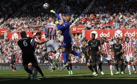 Britain Football Soccer - Stoke City v Liverpool - Premier League - bet365 Stadium - 8/4/17 Stoke City's Lee Grant punches clear Reuters / Darren Staples Livepic