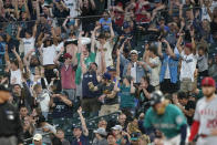 Fans do the wave during a baseball game between the Seattle Mariners and the Los Angeles Angels, Friday, July 9, 2021, in Seattle. (AP Photo/Ted S. Warren)