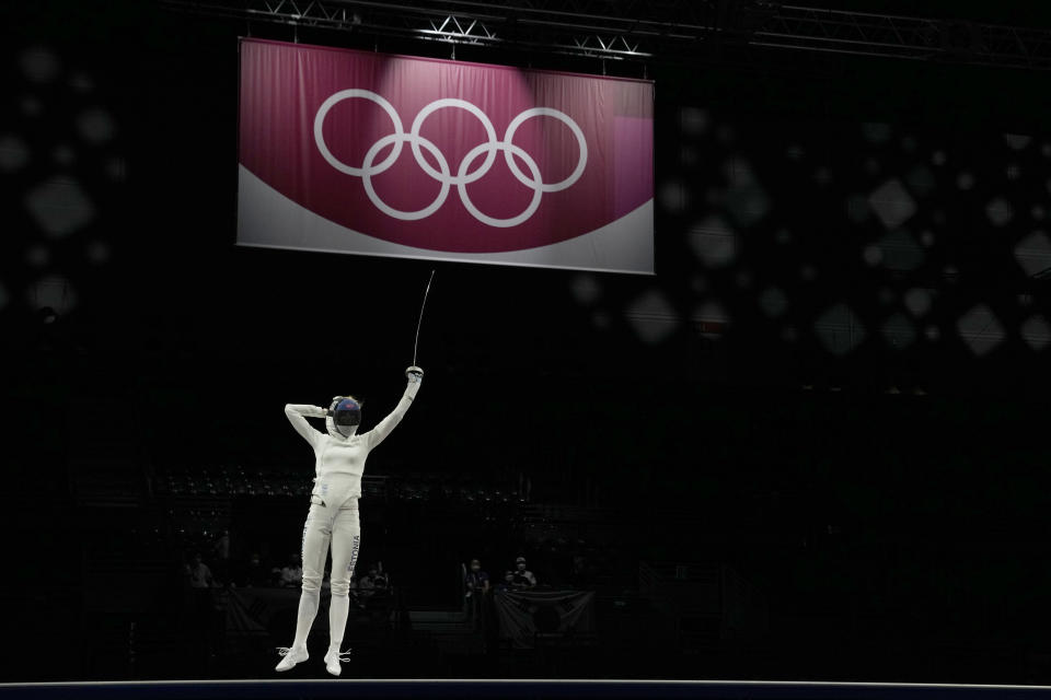 Katrina Lehis of Estonia celebrates winning with her team the gold medal against South Korea in the women's individual Epee team final competition at the 2020 Summer Olympics, Tuesday, July 27, 2021, in Chiba, Japan. (AP Photo/Hassan Ammar)