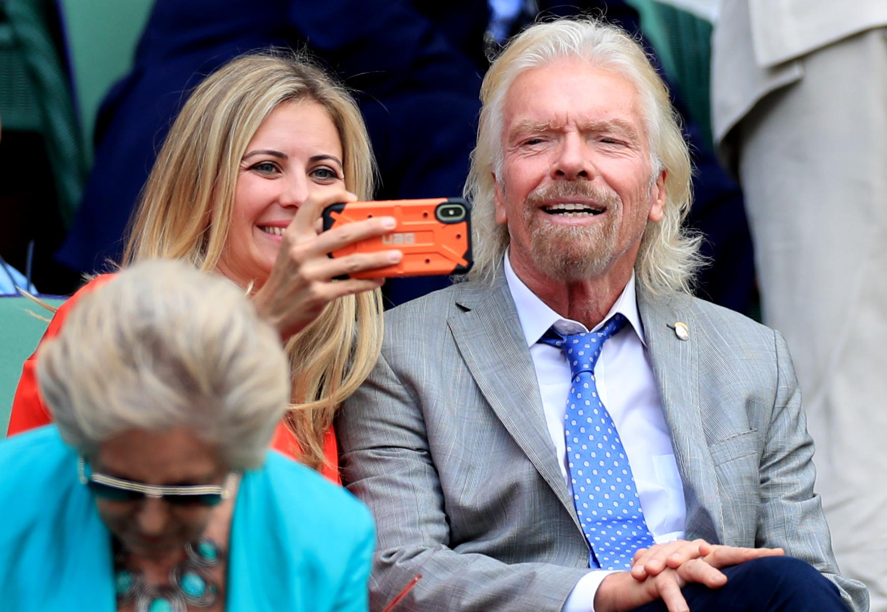 Sir Richard Branson and his Daughter Holly on day ten of the Wimbledon Championships at the All England Lawn Tennis and Croquet Club, Wimbledon.