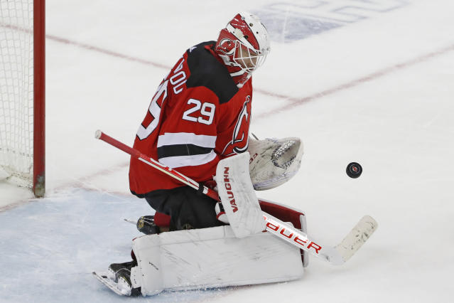 New Jersey Devils goaltender Mackenzie Blackwood (29) makes a save during the third period of an NHL hockey game against the Detroit Red Wings, Thursday, Feb. 13, 2020, in Newark, N.J. (AP Photo/Kathy Willens)
