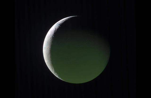 <p>The brightly lit limb of a crescent Enceladus looks ethereal against the blackness of space. The rest of the moon, lit by light reflected from Saturn, presents a ghostly appearance.This image is a composite of images taken with the Cassini spacecraft narrow-angle camera on March 29, 2017, using filters that allow infrared, green, and ultraviolet light. (Photo: NASA/JPL-Caltech/Space Science Institute) </p>