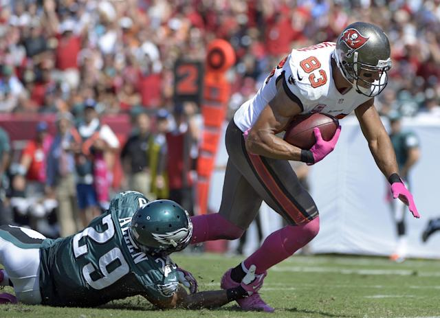 Tampa Bay Buccaneers wide receiver Vincent Jackson (83) is tripped up by Philadelphia Eagles strong safety Nate Allen (29) but scores on a 24-yard touchdown reception during the second quarter of an NFL football game Sunday, Oct. 13, 2013, in Tampa, Fla. (AP Photo/Phelan M. Ebenhack)