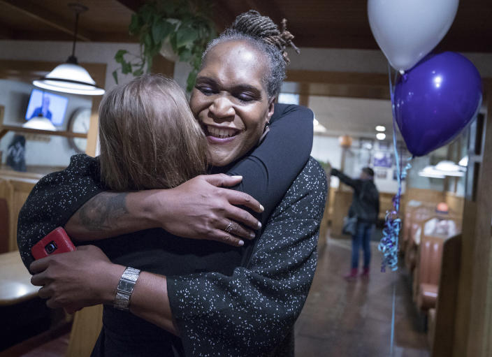 Andrea Jenkins hugs a supporter on Tuesday. (Photo: Carlos Gonzalez/Star Tribune via AP)