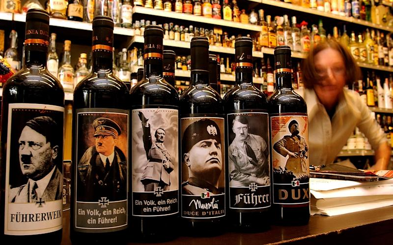 It is not uncommon to find wine decorated with images of Hitler and Mussolini in Italian off-licences - Getty