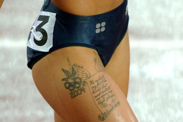 Olympic Rings, dove tattoo and biblical passage from the second book of Samuel on upper right thigh of 2004 Olympic women's 100-meter hurdle champion Joanna Hayes during the Women's 100m Hurdle Semifinals at the IAAF World Championships in Athletics at Olympic Stadium in Helsinki, Finland on Wednesday, August 10, 2005. (Photo by Kirby Lee/WireImage)