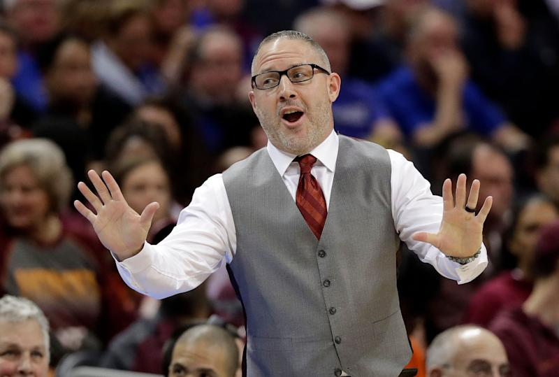 Virginia Tech head coach Buzz Williams jokes with Florida State head coach Leonard Hamilton, not shown, during the first half of an NCAA college basketball game in the Atlantic Coast Conference tournament in Charlotte, N.C., Thursday, March 14, 2019. (AP Photo/Chuck Burton)