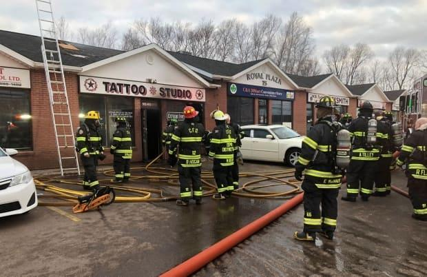 Firefighters were able to quickly extinguish the fire at Extreme Ink Tattoo Studio in Charlottetown on April 1. (Wayne Thibodeau/CBC - image credit)