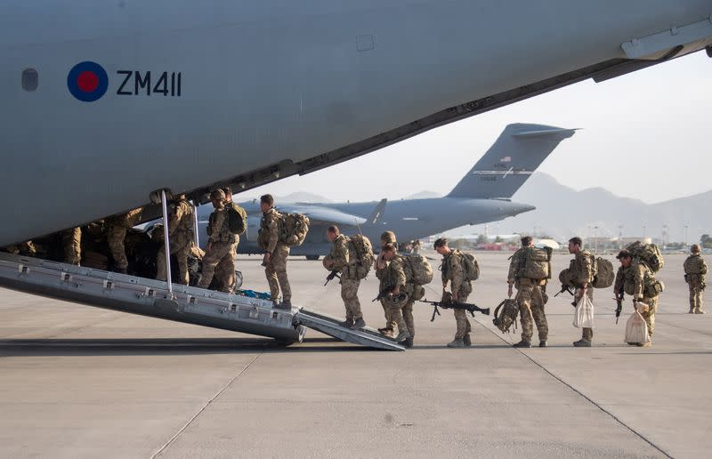 UK military personnel board an A400M aircraft departing Kabul