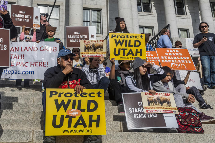 At the Utah State Capitol, protesters demonstrate against President Trump's plan to shrink protected areas across the country. (Photo: Michael Nigro/Pacific Press/LightRocket via Getty Images)