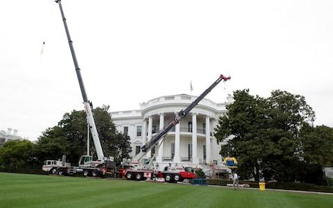 Construction cranes on the South Lawn of the White House looking towards the South Portico in Washington, DC is undergoing renovations - Credit: Alamy
