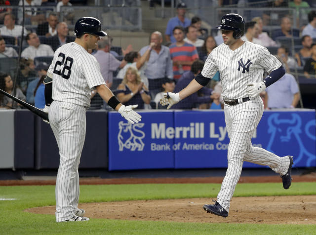 New York Yankees' Neil Walker, right, is congratulated by Austin Romine (28) after hitting a solo home run against the Texas Rangers during the sixth inning of a baseball game, Thursday, Aug. 9, 2018, in New York. (AP Photo/Julie Jacobson)