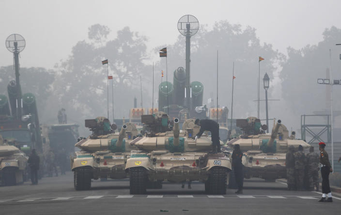 Indian army tanks are lined for the upcoming Republic Day parade in New Delhi, India, Thursday, Jan. 21, 2021. Republic Day marks the anniversary of the adoption of the country's constitution on Jan. 26, 1950. Thousands congregate on Rajpath, a ceremonial boulevard in New Delhi, to watch a flamboyant display of the country's military power and cultural diversity. (AP Photo/Manish Swarup)