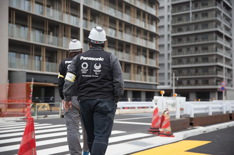 Construction site workers seen inspecting the Tokyo 2020 Olympic/Paralympic Village in Tokyo (Photo: SIPA USA/PA Images)