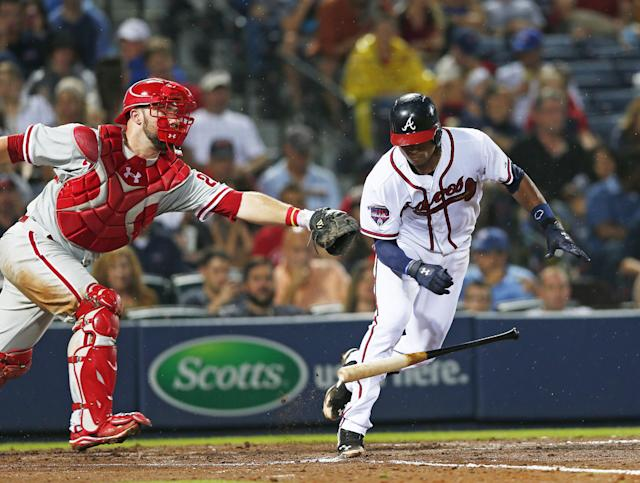 Philadelphia Phillies catcher Cameron Rupp reaches to tag out Atlanta Braves' Christian Bethancourt (25) after dropping the third strike in the fourth inning of a baseball game in Atlanta, Friday, July 18, 2014. Bethancourt was out at first base. (AP Photo/John Bazemore)