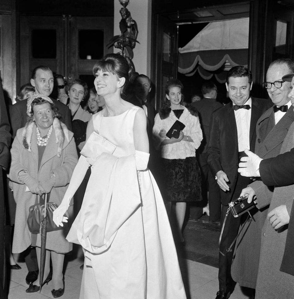 <p>Audrey Hepburn is all smiles at the 1961 London premiere of <em>Breakfast at Tiffany's</em>.</p>