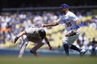 Los Angeles Dodgers first baseman Albert Pujols (55) catches San Francisco Giants' Evan Longoria stealing second base during the third inning of a baseball game Sunday, May 30, 2021, in Los Angeles. (AP Photo/Ashley Landis)