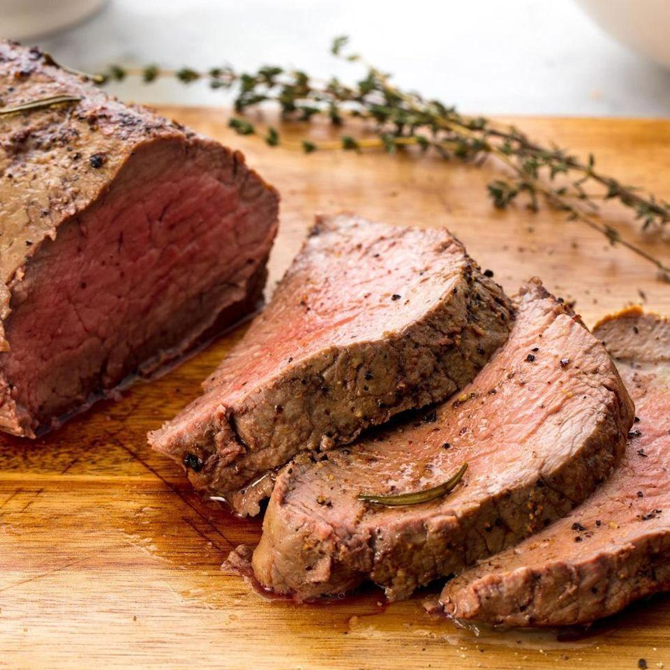 """<p>Beef tenderloin is actually insanely easy to make, thanks to a marinade made up of ingredients you probably already have and a surprisingly quick cook time. If you only want to use rosemary (or thyme), that's fine. Just double up on whichever herb you're using. </p><p>Get the <a href=""""https://www.delish.com/uk/cooking/recipes/a29559388/best-beef-tenderloin-recipe/"""" rel=""""nofollow noopener"""" target=""""_blank"""" data-ylk=""""slk:Beef Tenderloin"""" class=""""link rapid-noclick-resp"""">Beef Tenderloin</a> recipe. </p>"""