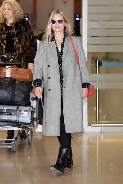 The supermodel touched down in South Korea in travel-friendly cowboy boots.