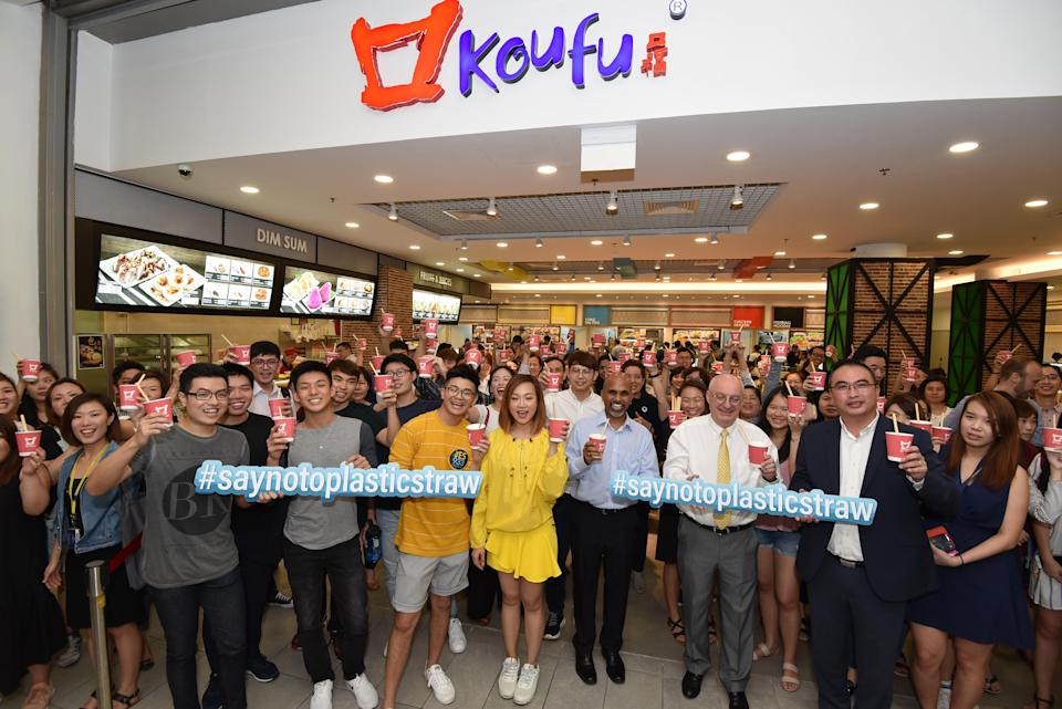 """(T<span>o commemorate the launch, 198 participants gathered at SMU's Koufu food court at 1pm on Thursday and broke the Singapore Book of Records for """"Most Number of People Drinking From Bamboo Straws"""".</span> PHOTO: Koufu)"""