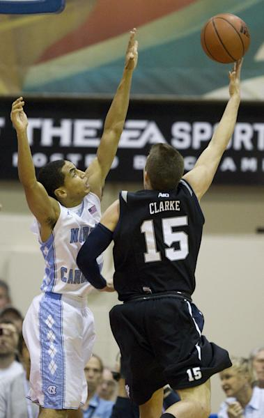 North Carolina guard Marcus Paige defends on a shot by Butler guard Rotnei Clarke (15) during the first half of an NCAA college basketball game in the Maui Invitational, Tuesday, Nov. 20, 2012, in Lahaina, Hawaii. (AP Photo/Eugene Tanner)