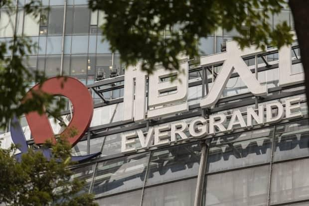 The logo of China Evergrande Group is shown on one of the company's buildings in Hong Kong. The property developer is in danger of collapsing under its debt load this week. (Qilai Shen/Bloomberg - image credit)